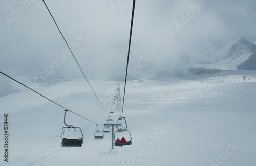 cables of skilift during blizzard