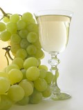 a glass of light wine and grape bunch poster