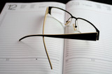 eyeglasses on notebook poster