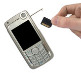 mobile phone and hand with memory card poster