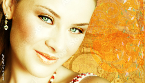 woman's face close-up on grunge background