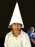 boy with dunce cap poster