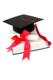 graduation cap and diploma on a book poster