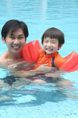man & boy in the pool