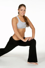 woman lunging in workout attire