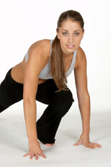 woman doing leg lunge in workout attire