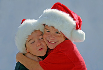 boys in christmas hats hugging