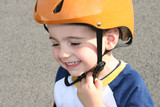 toddler in helmet poster