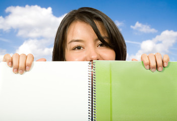 beautiful student looking over notebook