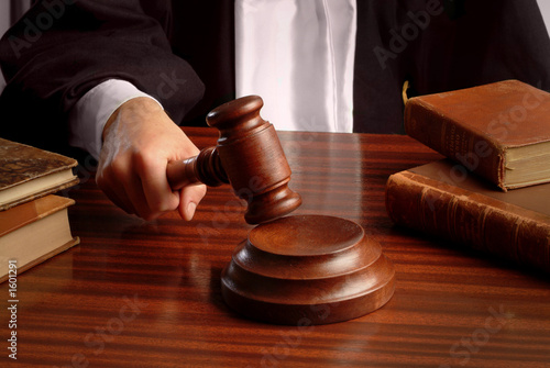 judge hand with gavel