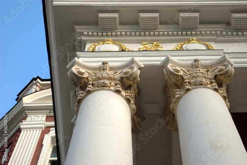 golden and white decorated columns
