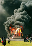 burning statue poster