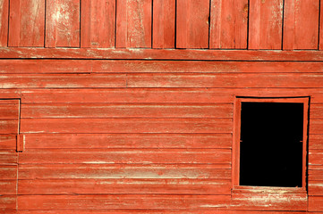 red barn black window