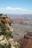 grand canyon overlook with people on ledge