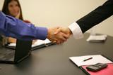 handshake in business office