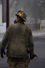 fireman with a mask on at a fire
