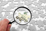 us dollar puzzle and magnifier poster
