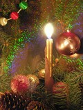 christmas tree and a burning candel poster