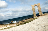 ancient arch - ruins over seashore - dynamic view poster