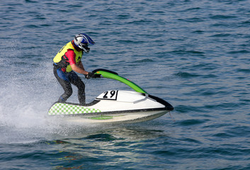 young man speeding along on jetbike during a race