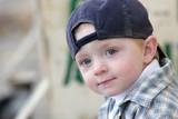 cute kid with baseball cap poster