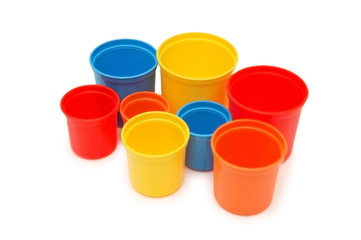various coloured cups isolated on white