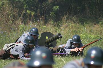 soldiers operating a machine gun iii