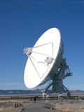 antenna - very large array with person below poster