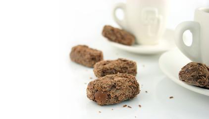 2 coffee cups and chocolates