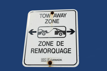 bilingual tow away zone sign