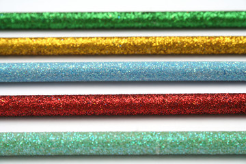 five celebratory color pencils with a sparkling covering macro