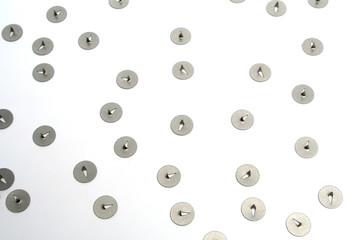 pile of  thumb tacks nickel plated represent danger