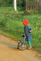 young girl with bicycle outdoors