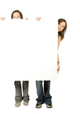 twin sisters holding a white banner poster