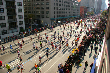 people running down the street in a marathon