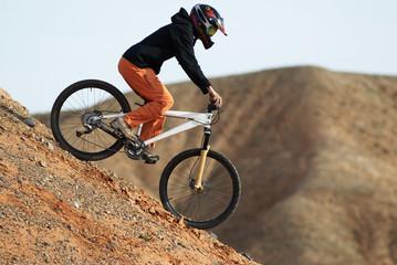girl downhill on bike