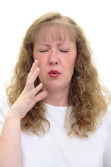 woman smells something really bad
