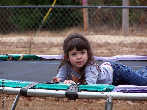 child on trampoline