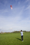 man flying a power kite poster