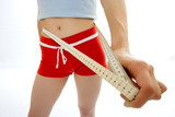 woman measuring waist poster