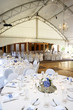 under a big tent during a wedding event