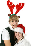 adorable teen couple in christmas hats. poster