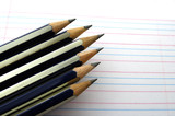 pointed pencils on a rules manuscript poster