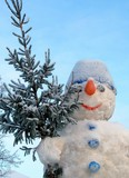 snow man with christmas tree