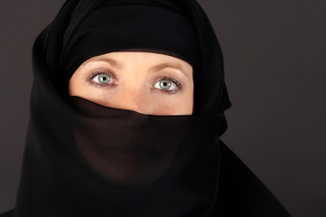 attractive woman covered by a veil