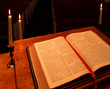 bible on pulpit in candlelight - angled view