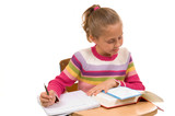 young girl at desk in school on white poster