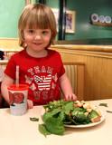 child eating at restaurant poster