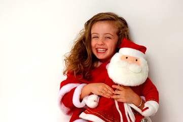 christmas girl holding stuffed santa claus