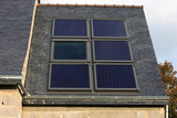 building with solar panels poster